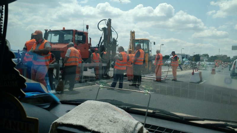 Roadside work in Romania. 12 people manages the 1 that is actually doing something
