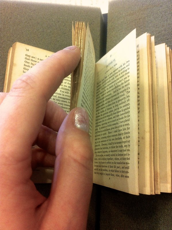 A giant manicule is attacking this little book!