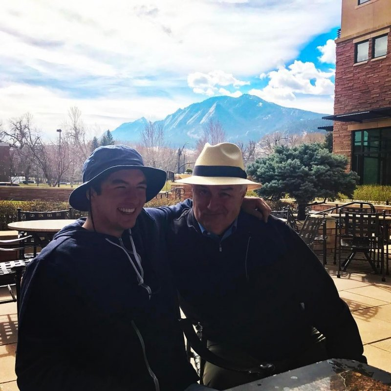 Me and my boy in front of the Flatirons.